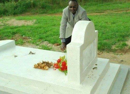Gen. David Sejusa lays a wreath on his late father's grave who died 3 months ago, this morning in Ssembabule.